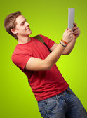 Casual man holding digital tablet — Stock Photo