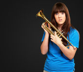 Portrait of a teenager playing trumpet — Stock Photo