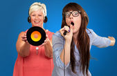 Two Woman Enjoying Music — Stock Photo