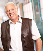 Senior Man Standing With Hand On Hips — Stock Photo