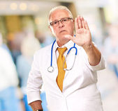 Portrait Of A Male Doctor Showing Warning Sign — Foto de Stock