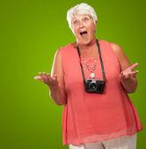 Senior Woman Wearing Camera Shrugging — Stock Photo