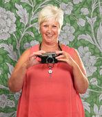 Senior Woman Holding Camera — Stock Photo