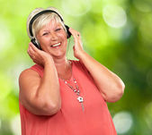Portrait Of A Senior Woman With Headphone — Stock Photo