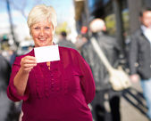 Portrait Of A Senior Woman Holding A Blank Card — Stock Photo