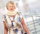 A Senior Woman Wearing A Neckbrace — Stock Photo