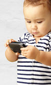Portrait Of Baby Boy Using Cell Phone — Stock Photo