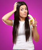 A Young Woman Holding A Banana — Stock Photo