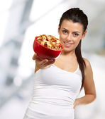 Young woman holding a cereal bowl — Stock Photo