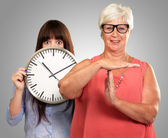 Senior Woman Showing Timeout Sign In Front Of Young Woman Holdin — Stock Photo