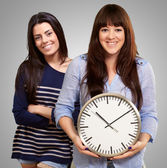 Portrait Of Happy Women Holding Clock — Stock Photo