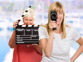 Two Happy Woman Holding Clapper Board And Camera — Stock Photo
