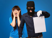 Burglar Man Holding Paper In Front Scared Woman — Stock Photo
