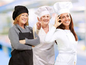 Three Happy Female Chef Gesturing — Stock Photo