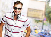Portrait Of A Handsome Young Man Listening To Music — Stock Photo