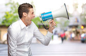 Portrait Of Young Man Holding Megaphone — Stock Photo