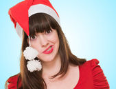 Funny woman wearing a christmas hat — Stockfoto