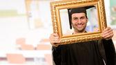 Graduate man looking through a frame — Stock Photo