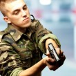 Portrait of a serious soldier aiming — Stock Photo