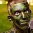 Stock Photo: Closeup of angry soldier with painting