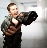 Angry Soldier Holding Gun — Stock Photo