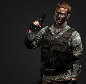 Portrait Of Soldier Holding Gun — Stock Photo