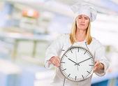 Female Chef Holding Clock — Stock Photo