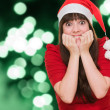 Stock Photo: Extremely excited woman wearing a christmas hat
