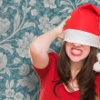 Angry woman with a christmas hat covering her eyes — Stock Photo