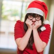Stock Photo: Excited christmas womwith her eyes shut