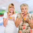 Two Happy Woman Drinking Juice — Stock Photo