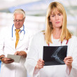 Portrait Of Two Busy Doctors - Stock Photo