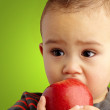 Portrait Of Baby Boy Eating Red Apple — Stock Photo #16304421