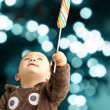Portrait Of Baby Boy Holding Lollipop — Stock Photo #16304459
