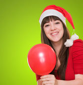 Happy christmas woman holding a balloon — Foto Stock