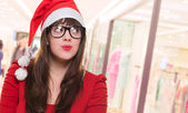 Christmas woman wearing glasses and looking up — Stock Photo