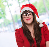 Christmas woman wearing glasses and making a wish — Stock Photo