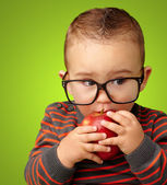 Portrait Of Baby Boy Eating Red Apple — Stock Photo