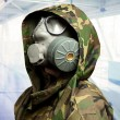 Closeup of soldier wearing gas mask — Stock Photo #18770379