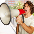 Stock Photo: Portrait Of A Handsome Young Man Shouting With Megaphone