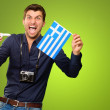 Man holding flag and miniature airplane — Stock Photo