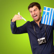 Stock Photo: Man holding flag and miniature airplane