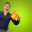 Man holding a flag and cheering - Stock Photo