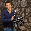 Happy Young MHolding Clapboard — Stock Photo #18778217