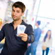 Young Man Holding Gold Bar And Euro Currency — Stock Photo #18778709