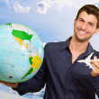 Young Man Holding Globe And Miniature — Stock Photo #18778763
