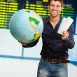 Portrait Of A Happy Young Man With Globe And Boarding Pass — Stock Photo #18778779