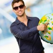 Young MWearing Goggle Showing Destination — Stock Photo #18778905