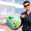 Young MWearing Goggle Showing Destination — Stock Photo #18778951