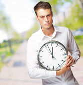 Angry Man Holding A Clock — Stock Photo